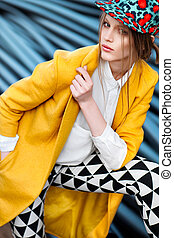 yellow coat - color bright woman fashion model outdoor...