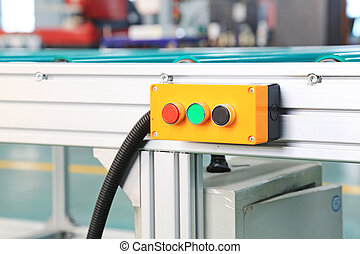 color button on the production line in a factory