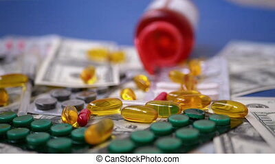 Color Capsules Falling on Dollar Bills. Expensive Medicines. Pharmacy Business