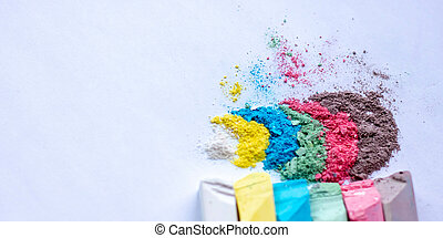 Color chalk powder cyan magenta yellow black isolated on white background.