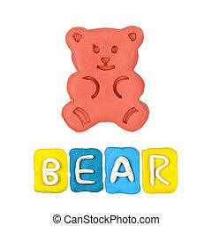 Color children's bear plasticine on a white background