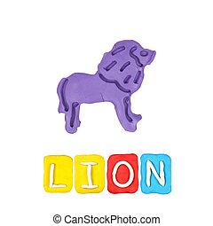 Color children's lion plasticine on a white background