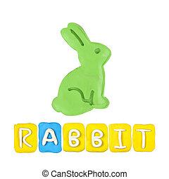 Color children's rabbit plasticine on a white background