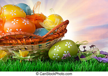 color easter eggs in basket against sky and clouds