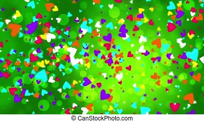 Color falling hearts on a green background