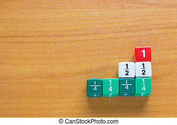 Color fraction dices on wood table