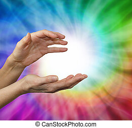 Color healing therapist - Female hands cupped in energy...