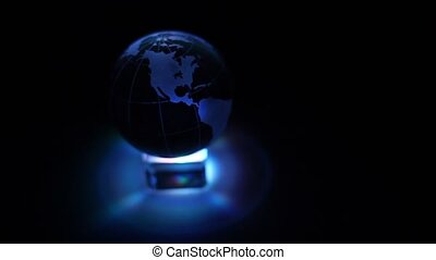 Color illumination box and sphere with world map on it spin...