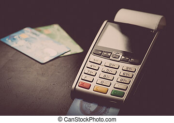 POS and credit cards - Color image of a POS and credit...
