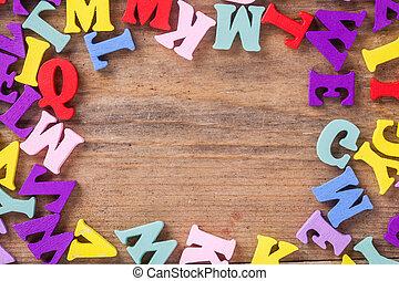 Color letter on wood background