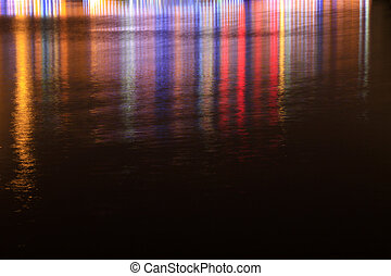 color light at night on the surface of water