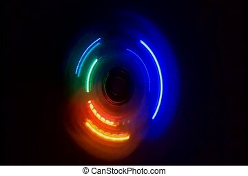Color light neon of spinning in the dark background