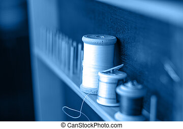 Thread needle button