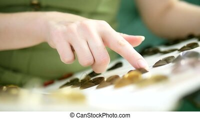 Color palette and selection of hair color. woman chooses a...