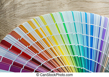 Color pantone fan on wooden meter.