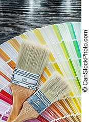 Color pantone fan paint brushes on wooden board top view