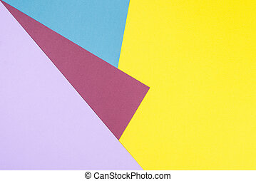 Color papers geometry flat composition background with yellow, red, orange, brown, blue tones.