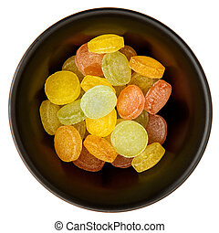 Color pastiles sweets in a black plate