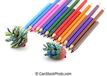 Color pencils and felt-tip pen with forest cones. Shallow DOF.