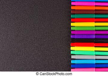 Color pencils on black background - Multy Color pencils on...