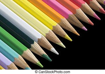 Color pencils on black background