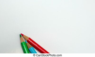 Color pencils spread around, stop-motion,