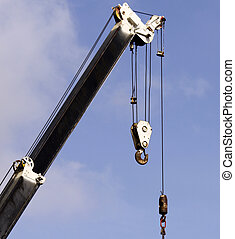 detail of a derrick boom crane with hook - color photo ...
