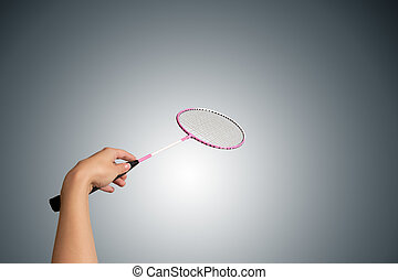 Color photo of one racket for badminton and female hand...