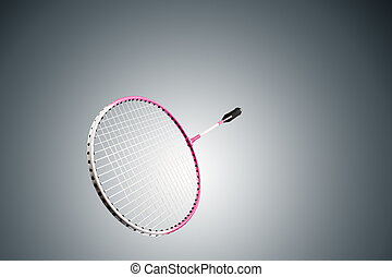 Color photo of one racket for badminton isolated on gray