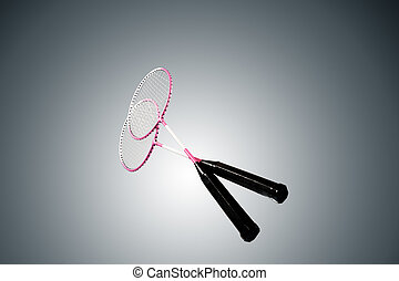 Color photo of two rackets for badminton isolated on gray