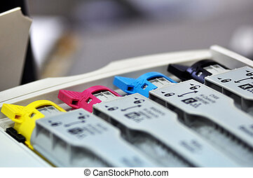 This photograph represent 4 inks cartridges of a color printer