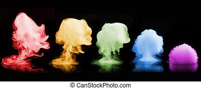Color smoke explosion isolated on black