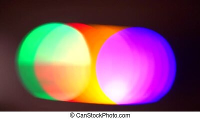 Color spots of matrix illumination in bokeh effect on a black background.