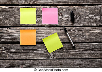Color sticky note paper sheets fountain pen. Closeup on old...