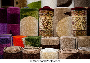 Colorful Collection Of Carpets And Rugs Folded And Displayed. Textured Carpet Surface Detail Specific View