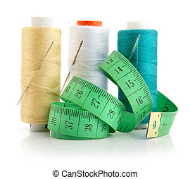 color threads with needles and green measuring line -...