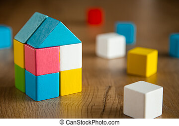 color wooden block form of house shape