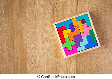 color wooden block on wooden background