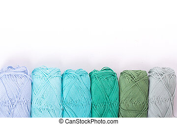 colorful yarn in white background