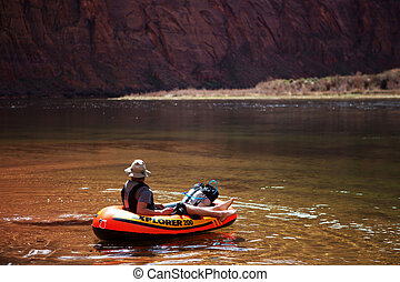 Packrafting down the colorado river in a small inflatable raft