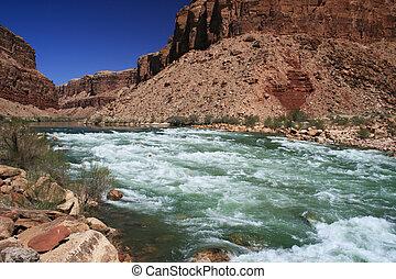 the Colorado River flows through Badger Creek rapid in Marble Canyon, Grand Canyon, Arizona