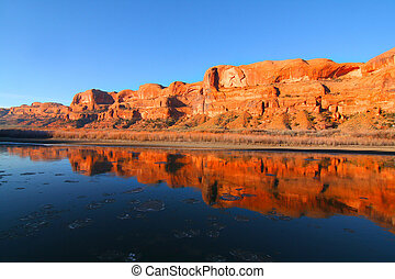 Red rock reflections on the Colorado River with Blue sky�s