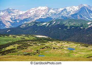Colorado Rocky Mountains Panorama. Snowy Peaks and the Green...