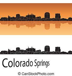 Colorado Springs skyline in orange background in editable...