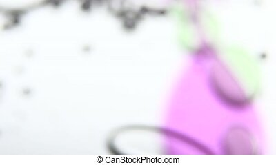 Colored acrylic drops. White. Close up - Lot of colored...