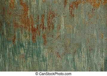 colored and rusty iron texture from a fragment of the wall