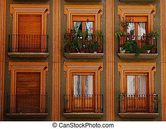 Colored balconies - Warm-colored balconies in Granada