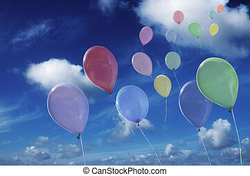 colored ballons against cloudy sky - Lots of colorful ...