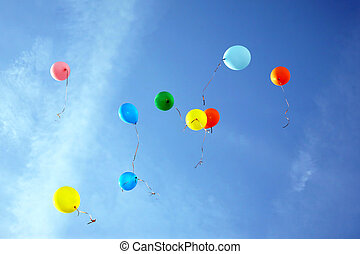 colored balloons flying in the blue sky
