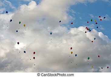 colored balloons flying in the sky